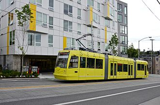 First Hill Streetcar - Car 403 on Yesler Way, passing a new apartment building