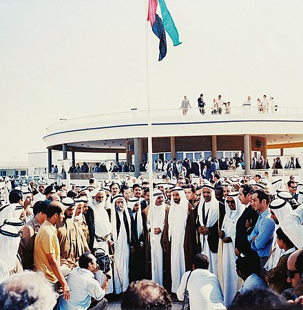Historic photo depicting the first hoisting of the United Arab Emirates flag by the rulers of the emirates at The Union House, Dubai on 2 December 1971 Flag-hoisting at the Union Declaration.jpg
