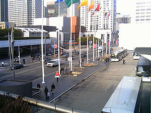 Colored flags flying high outside the Moscone ...