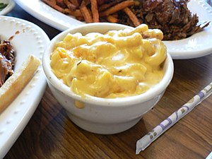 Macaroni and cheese in a white bowl.