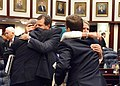 Florida State Representatives embrace eachother after the House officially ended Regular Session.jpg