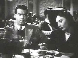Fred MacMurray and Barbara Stanwyck in Remember the Night trailer.JPG