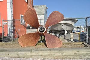 Freeport, NY - gilded propeller at AquaMarina on Hudson Canal.jpg