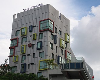 Gallery Hotel - A twisted cuboid form, with random and multi-coloured windows, stands like a pop art signpost at the Mohamad Sultan Road end of the Gallery Hotel. The rooftop lap pool with its cantilevered glass form overlooking the street is the first of its kind in Singapore.