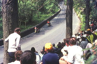 Glen Helen, Isle of Man - TT race spectators at the exit to Glen Helen in 1969 with two travelling marshals passing by towards Creg Willey's Hill