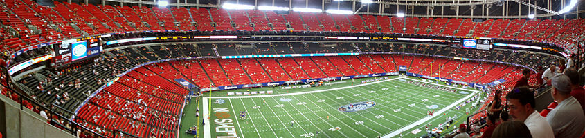 Fans enter the red and black seats in the Georgia Dome prior to the game.