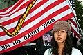 Girl in front of flag.jpg