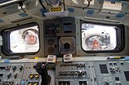 Good & Reisman Look Through The Aft Flight Deck Windows Of Atlantis STS-132 EVA 3