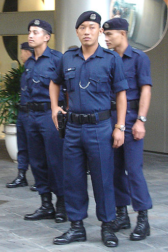 Gurkha Contingent - Off-duty officers of the Gurkha Contingent wearing the beret with their old No. 4 dress, gathering at Raffles City during the 117th IOC Session.