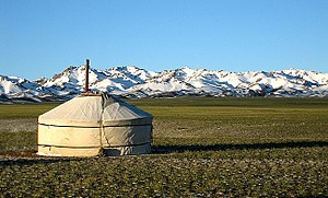 English: Yurt with the Gurvansaikhan Mountains...