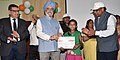 """Hardeep Singh Puri distributing the prizes to the winners for Painting, Essay, Slogan, Graffitti competition, at a function, organised by Hindustan Prefab Limited, as part of the """"Swachhta Hi Seva"""" Abhiyan, in New Delhi.JPG"""