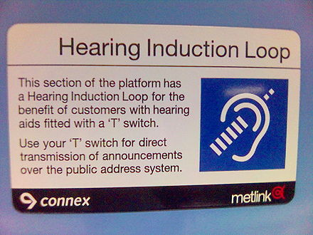 "A sign in a train station explains that the public announcement system uses a ""Hearing Induction Loop"" (audio induction loop). Hearing aid users can use a telecoil (T) switch to hear announcements directly through their hearing aid receiver. Hearing induction loop hearing aid.jpg"