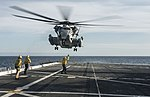 Helicopters depart USS Mesa Verde to conduct a site survey over Haiti. (30203079296).jpg