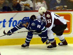 Adam Foote - Foote defending against the Vancouver Canucks' Henrik Sedin in 2010