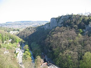 Matlock Bath - View of High Tor from the cable car showing the A6 road through the Bath with Matlock town in the distance