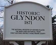 Signs at the entrance and exit of Glyndon note the 19th century village's historic significance.