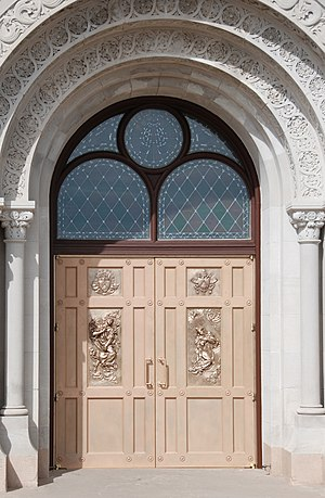 Holy Hill National Shrine of Mary, Help of Christians - The central cast-bronze entry doors at Holy Hill National Shrine of Mary depicting The Annunciation with Gabriel the Archangel and Our Lady.