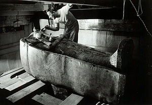 Harry Burton (Egyptologist) - Howard Carter in Tutankhamen's tomb, photographed by Harry Burton