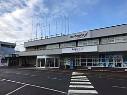 "Image shows the facade of a modern low-rise building with the legend ""Humberside Airport"" carried on signage."