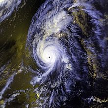 A view of Hurricane Iniki from Space on September 11, 1992. The storm is situated over the Hawaiian Islands, and is surrounded by open waters of the Pacific. Iniki's eye, seen near the center of the image, is well-defined, and representative of an intense hurricane.