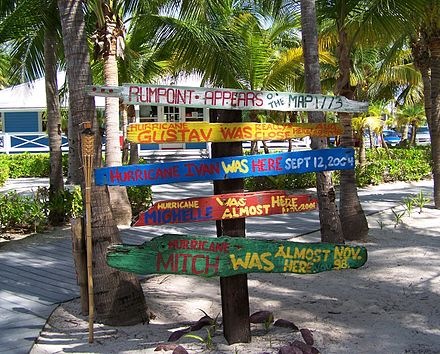 Signs at Rum Point commemorating landed and near-miss hurricanes Hurricane signs rum point.jpg