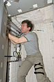 ISS-20 Michael Barratt works inside a crew quarters in the Kibo lab.jpg