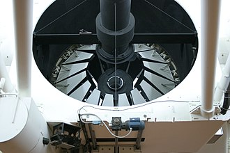 Isaac Newton Telescope - Isaac Newton Telescope Mirror, with the primary mirror cover petals almost closed.