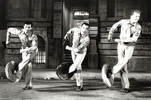 Michael Kidd - Kidd's screen acting debut, dancing with Gene Kelly and Dan Dailey in It's Always Fair Weather (1955)