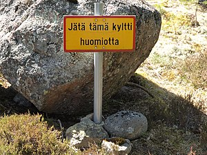 "Sign - A sign saying ""Ignore this sign"" in Finnish, an example of a humorous sign."