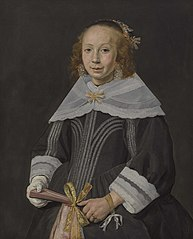 Portrait of a young woman holding a fan