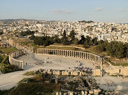The Oval Forum of Jerash (c. 1st century AD), then part of the ten-city Roman league, the Decapolis. Jerash 01 (cropped).jpg
