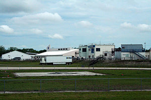 AXS TV - An HDNet production trailer is stored between launches at the Kennedy Space Center press area. NASA space shuttle launches aired on HDNet.