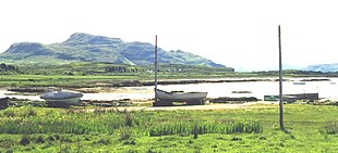 Kilchoan Bay.  Ben Hiant, the highest point of the peninsular rises beyond the small moored boats and bay.