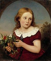 Tyttö kukkia kädessä