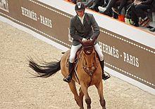Le cavalier Kevin Staut pendant le saut Hermès 2012. d850485ad8d