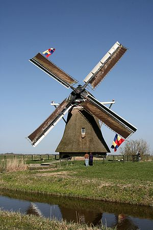 English: Lekkum: Bullemolen with flags Nederla...