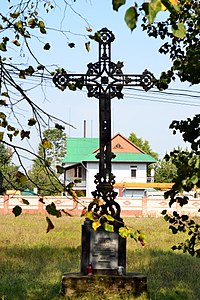 Liubeshiv Volynska-church and cells of the Capuchin monastery-cross dedicated to the destroyed inhabitants.jpg