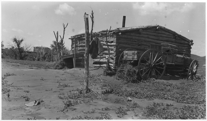 File:Log cabin with wagon parked beside it - NARA - 285822.tif