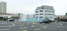 London Heliport - Battersea - London - 2 helicopters awaiting takeoff - evening - 030604.jpg