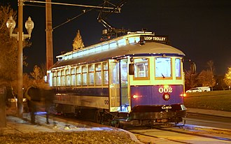 Loop Trolley - Blue car 002 (ex-Portland 511) at the Missouri History Museum stop in the first month of service