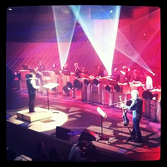 """Luciano Chessa - Luciano Chessa conducting the premiere of """"It All Begins Now"""" by Lee Ranaldo, with Lee Ranaldo and the New World Symphony. A Performa Commission, New World Center, Miami Beach, December 2011."""