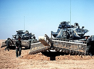 M728 Combat Engineer Vehicle - M728A1s of 72nd Engineering Company, 24th Infantry Division, inspecting a mine-clearing rake, Operation Desert Storm 18-FEB-1991