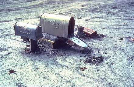 Mailboxes caught in a mudflow following the May 1980 Saint Helens volcanic eruption. MSH80 mailboxes along cowlitz river 1980.jpg