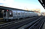 A train made of R179 cars in J service arriving at Flushing Avenue, bound for Manhattan.