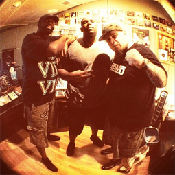 Arnell (center) with Malik B. (left) and Vinnie Paz in 2014