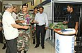 Manohar Parrikar accompanied by the Director General Border Roads, Lt. Gen. R.M. Mittal visiting the exhibition stalls set up by various engineering companies.jpg