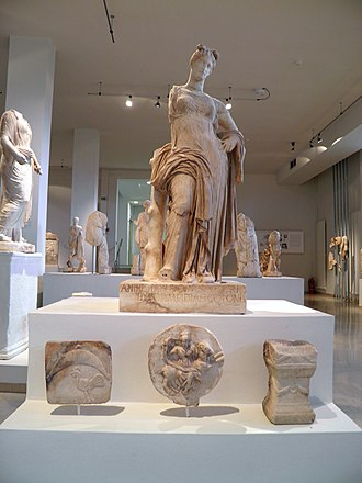 Tourism in Greece - Statue of goddess Aphrodite and votive offerings, Heraklion Archaeological Museum