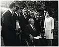Mayor John F. Collins and First Lady Lady Bird Johnson with group of unidentified men at meeting of United States Conference of Mayors in Washington, D.C. (10425991293).jpg