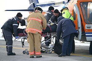 A woman is loaded into an air ambulance that l...