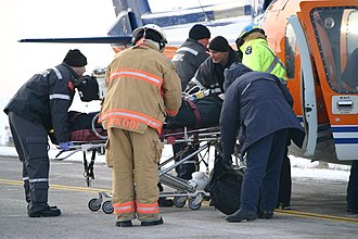Emergency medical services - Emergency medical services prepare to airlift the victim of a car accident to hospital, in Ontario, Canada.